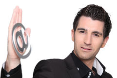 Man holding at symbol Stock Photography