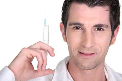 Man holding syringe Royalty Free Stock Photos
