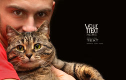 Man holding tabby cat. With big green eyes Stock Images