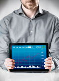 Man Holding Table with Conceptual Graph Display Royalty Free Stock Image
