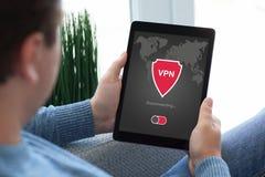 Man holding tablet app vpn creation Internet protocols protectio Stock Photos