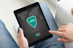 Man holding tablet app vpn creation Internet protocols protectio Royalty Free Stock Photos