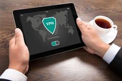 Man holding tablet app vpn creation Internet protocols protectio Stock Image