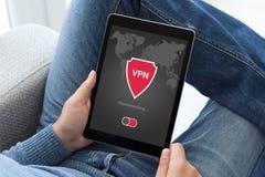 Man holding tablet app vpn creation Internet protocols protectio Stock Photography