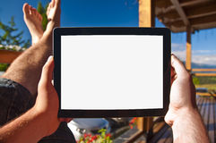 Man holding a tablet on balcony sunbathing - point of view photo Stock Images