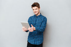Man holding tablet computer in hands stock image