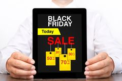 Man holding tablet computer with sale black Friday on screen Stock Photography