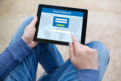 Man holding tablet computer with social network on the screen Royalty Free Stock Images