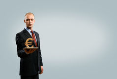 Man holding tablet with euro symbol Stock Photos