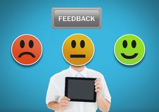 Man holding tablet with feedback smiley satisfaction icons. Digital composite of Man holding tablet with feedback smiley satisfaction icons Royalty Free Stock Images