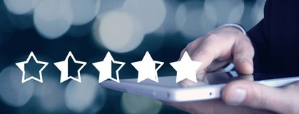 Man holding tablet. Five stars. Increase rating stock photos
