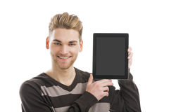 Man holding a tablet. Good looking young man showing something on a tablet Royalty Free Stock Photos