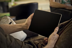 Man holding tablet Stock Images