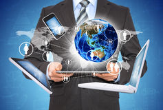 Man holding tablet. Near the earth and electronics Stock Photography