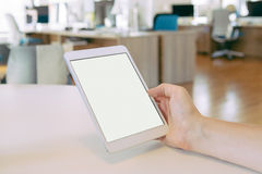 Man holding tablet pc in the office Stock Photo