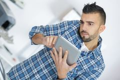 Man holding tablet pc to find problem Royalty Free Stock Photo