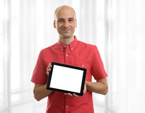 Man holding a Tablet PC. Young man holding a Tablet PC Royalty Free Stock Images