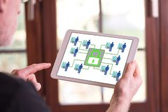 Personal data security concept on a tablet. Man holding a tablet showing personal data security concept stock image