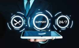 Man holding tablet. 24/7 Support Service stock photo