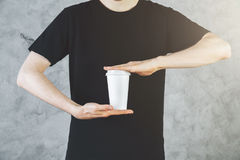 Man holding take out coffee cup Royalty Free Stock Images