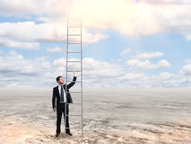 Man holding tall ladder Royalty Free Stock Photography