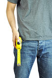 A man holding a tape measure. A man wearing jeans holding a tape measure Royalty Free Stock Photography