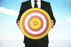 Man holding a target for darts Royalty Free Stock Photos