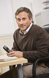 Man Holding Telephone Royalty Free Stock Photography