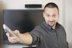 Man holding  television  remote controller Royalty Free Stock Photo