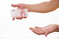 Man holding ten euro and showing an empty palm Stock Photo