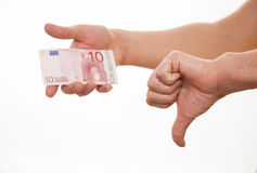 Man holding ten euro and showing thumb down sign Royalty Free Stock Images
