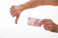 Man holding ten euro and showing thumb down sign Royalty Free Stock Photo