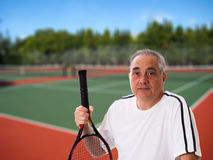Man holding tennis racket royalty free stock photos
