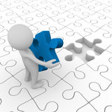 Man Holding The Final Puzzle Piece Royalty Free Stock Photography