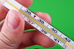 Man holding a thermometer Stock Images