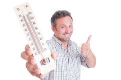 Man holding thermometer and showing like Royalty Free Stock Images