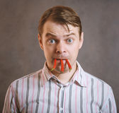 Man is holding three chili peppers. Royalty Free Stock Image