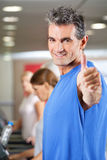 Man holding thumbs in up in gym Stock Photos