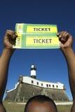 Man holding tickets in Salvador Brazil at Farol da Barra Lighthouse Royalty Free Stock Photo