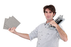 Man holding tile cutter Stock Photography