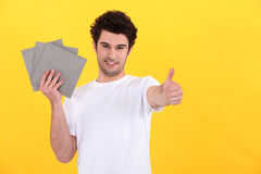 Man holding tiles Stock Image