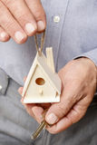 Man holding tiny wooden house Stock Image