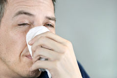 Man Holding Tissue On Nose Stock Images