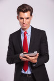 Man holding touch pad & smiling Stock Photos