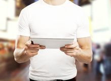 Man holding touch pad Royalty Free Stock Image