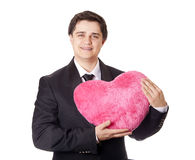 A man holding toy heart Stock Image