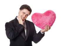 Man holding toy heart Stock Photography