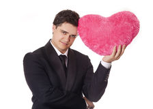 Man holding toy heart Stock Photos