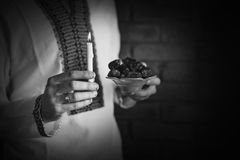 Man holding traditional ramadan food at night Royalty Free Stock Photography