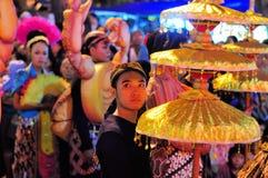 Man holding a traditional umbrella, Yogyakarta Royalty Free Stock Photo